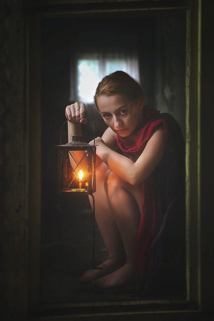 woman holding candle lantern framed photo